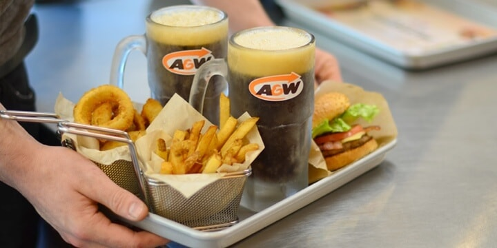 Tray with fries, onion rings, root beer and burgers
