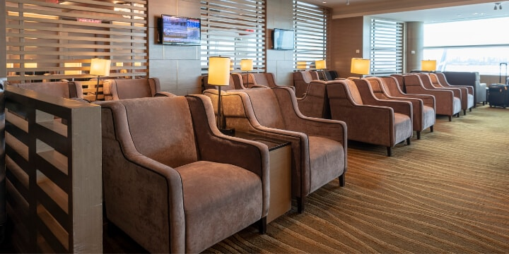 Rows of plush club chairs in lounge.